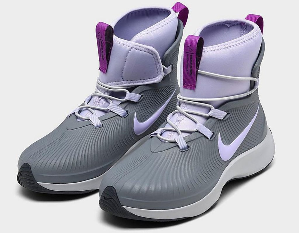 grey and purple pair of high top nike girls shoes