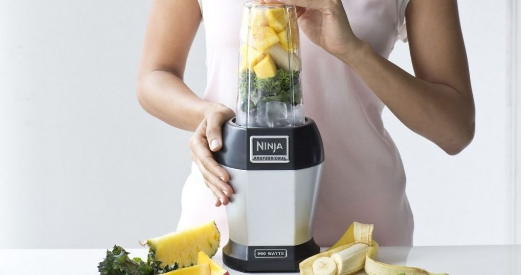 lady using Nutri Ninja 900w Blender with fruit