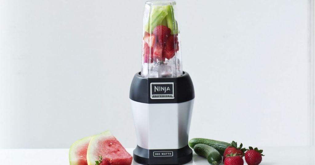 Nutri Ninja Single Serve Blender on counter with fruit