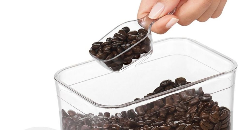 hand scooping coffee beans with OXO Coffee Scoop