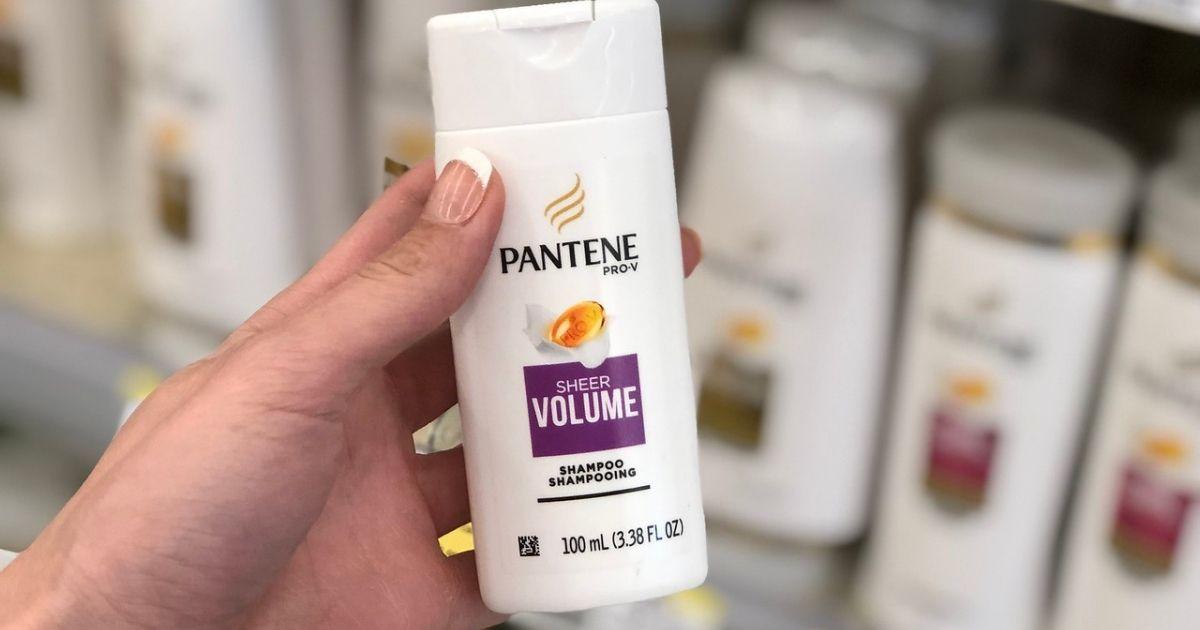 Woman holding small bottle of Pantene