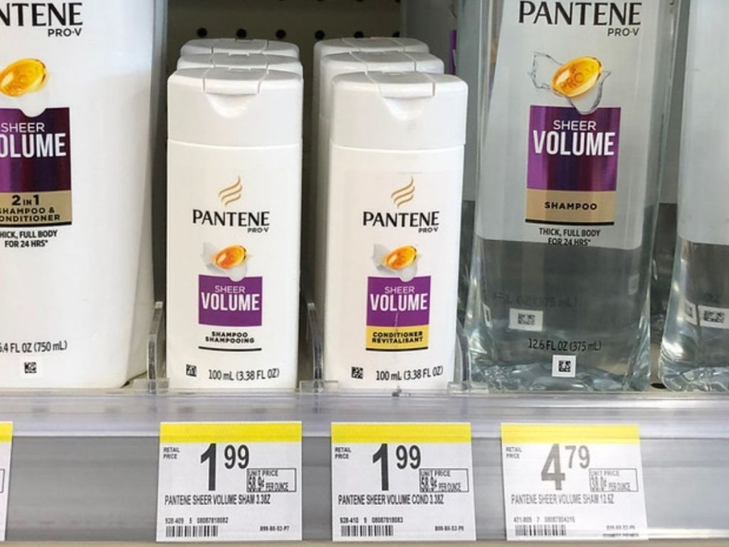 Store shelf with small bottles of Pantene Shampoo and Conditioners