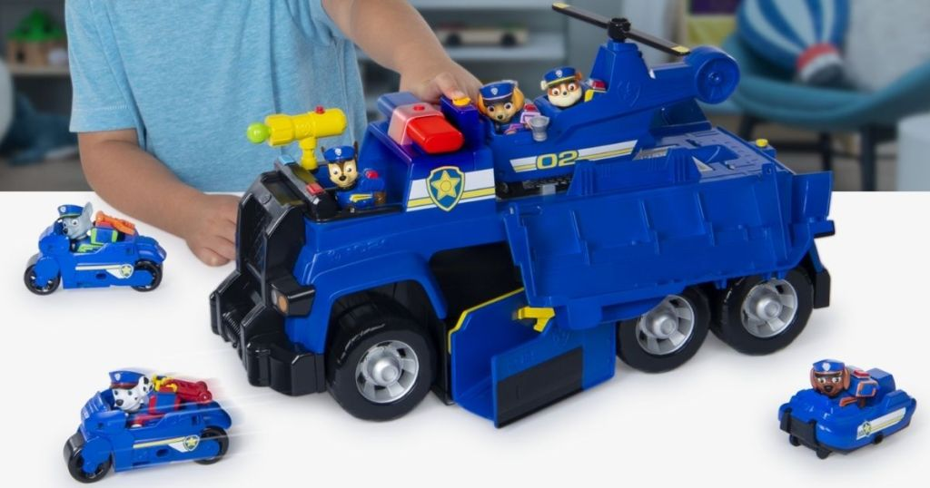 boy playing with a Paw Patrol Cruiser
