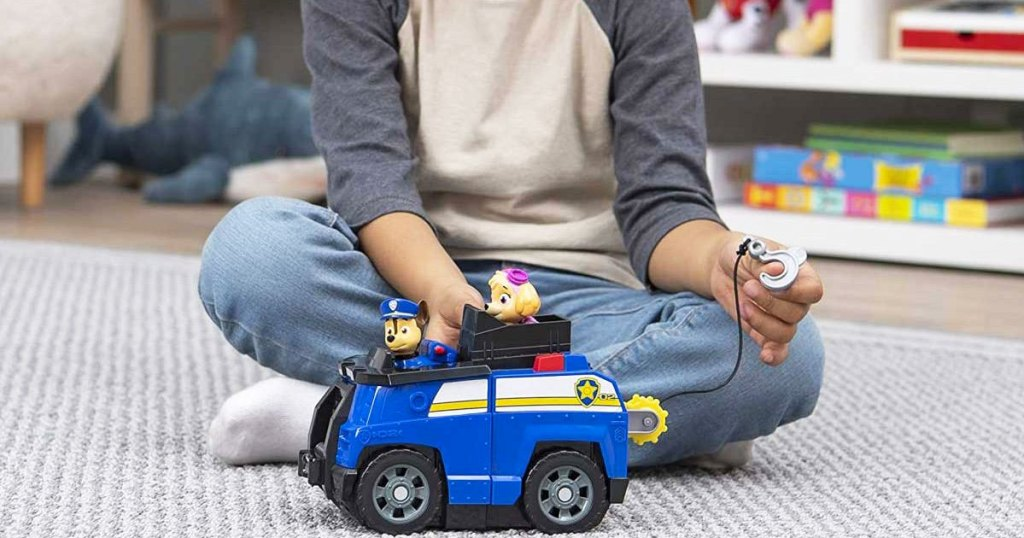 little boy playing with police car toy