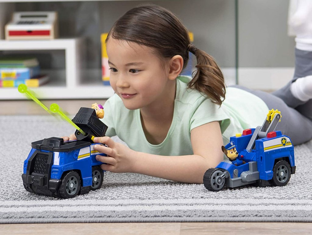 girl playing with Paw Patrol Chase Split-Second 2-in-1 Transforming Police Cruiser