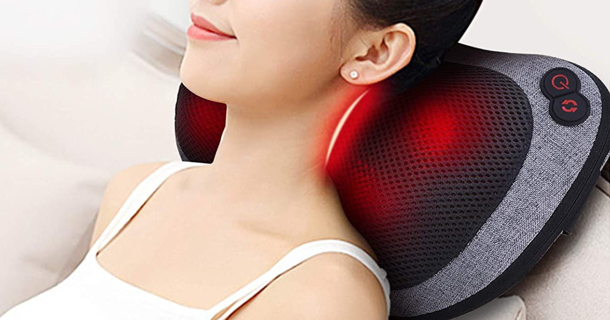 Woman laying against a neck massager