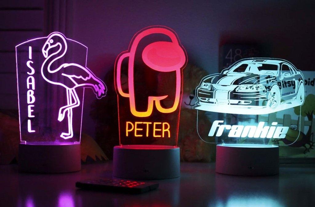 three personalized kids nightlights on nightstand