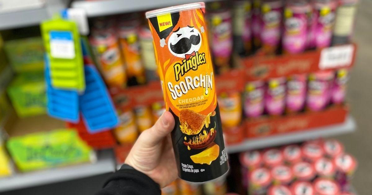 hand holding Pringles Scorchin Chips