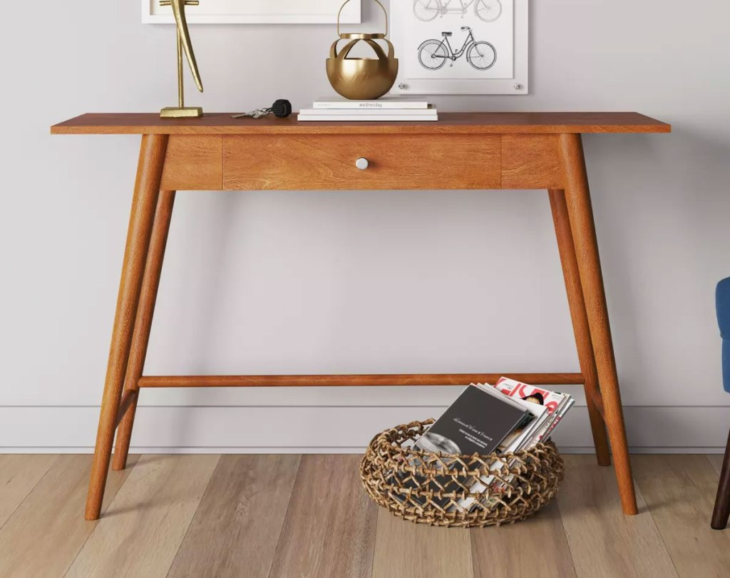 wood writing desk against a wall