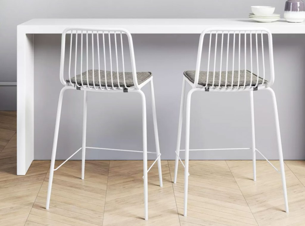 two white barstools at counter