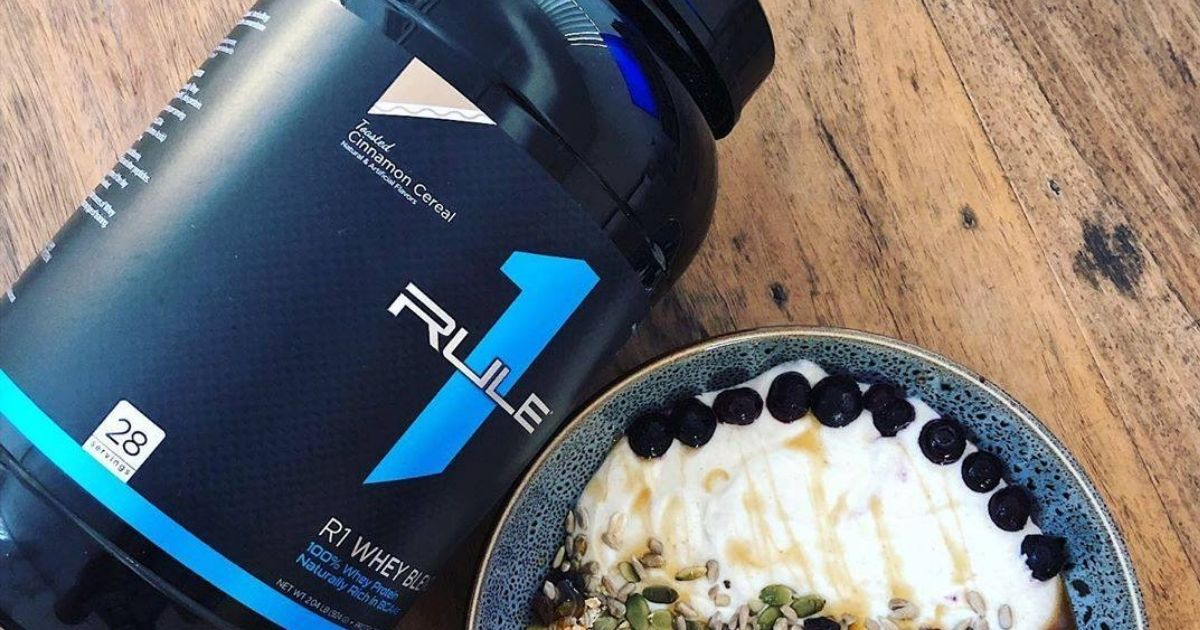Rule 1 Whey Protein with plate of food