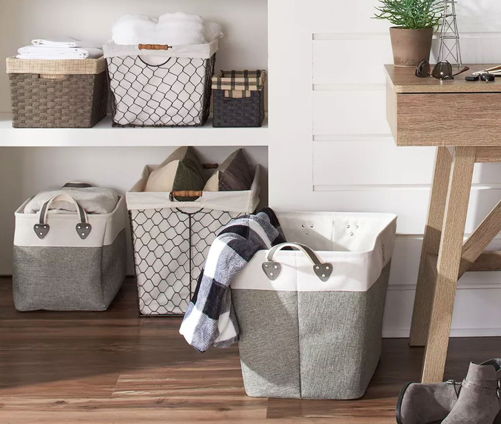 collection of fabric and wire baskets in storage closet
