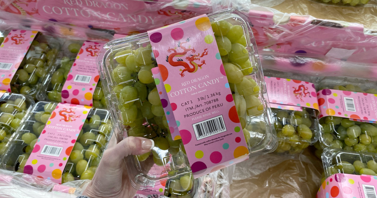 Hand holding a package of cotton candy grapes