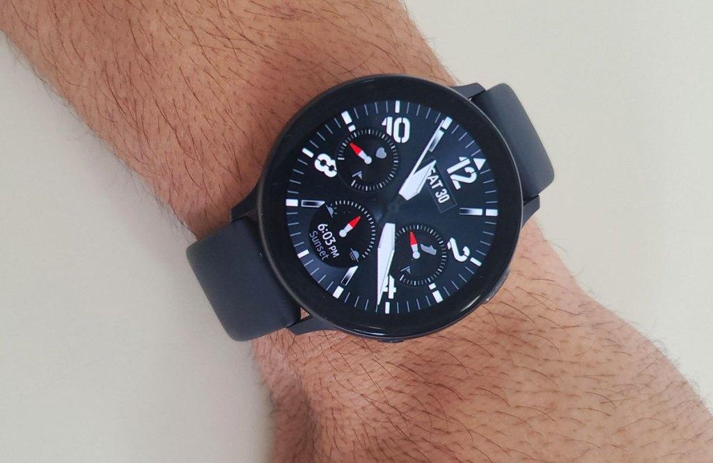 man with black samsung galaxy smartwatch on wrist