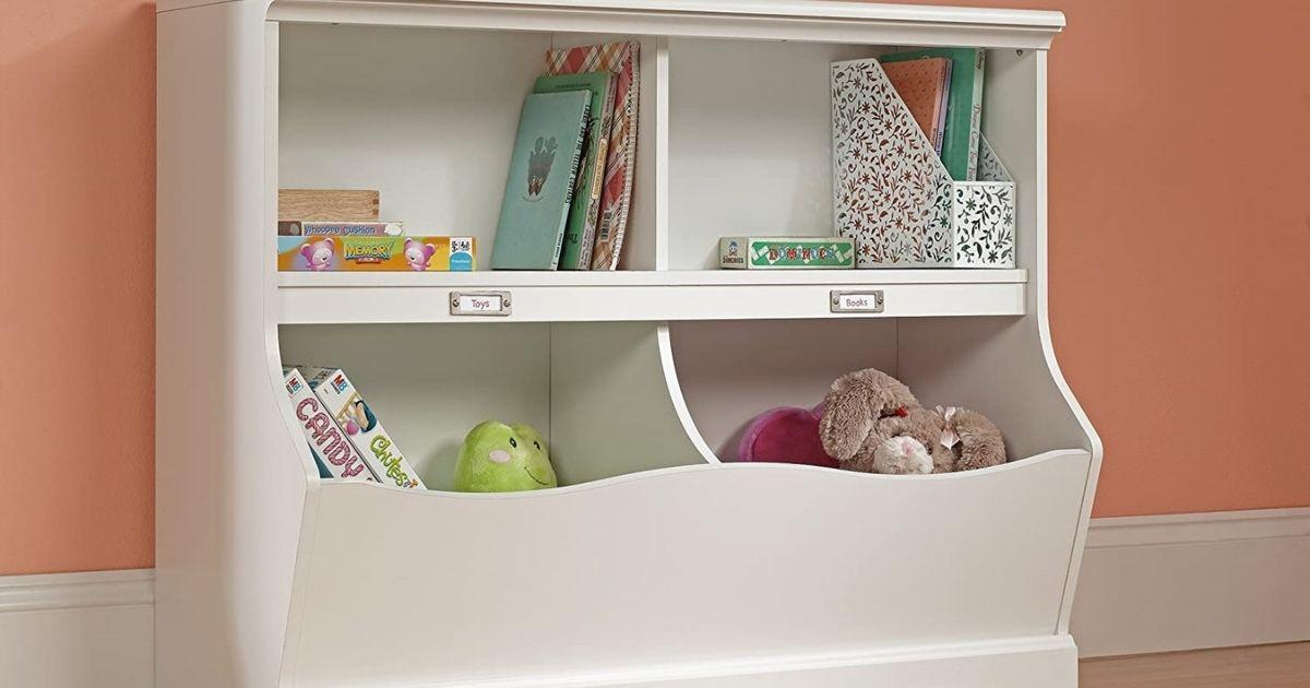 white shelf and bookshelf holding books and stuffed animals