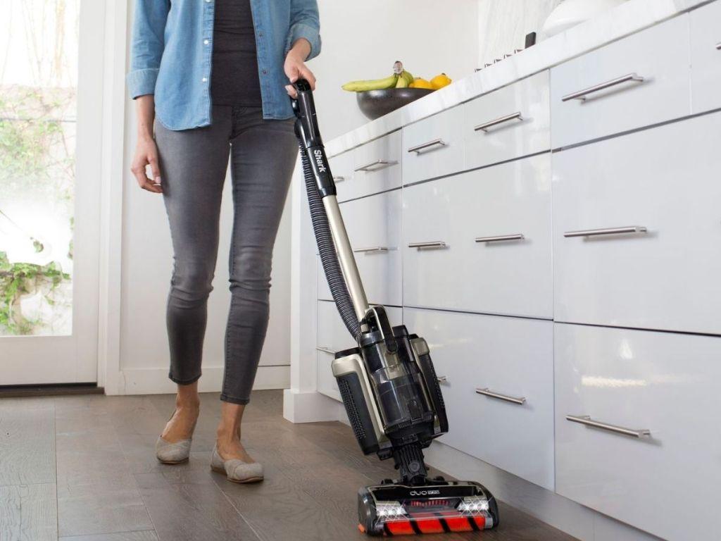 woman using Shark Refurbished ION P50 Lightweight Cordless Upright Vacuum