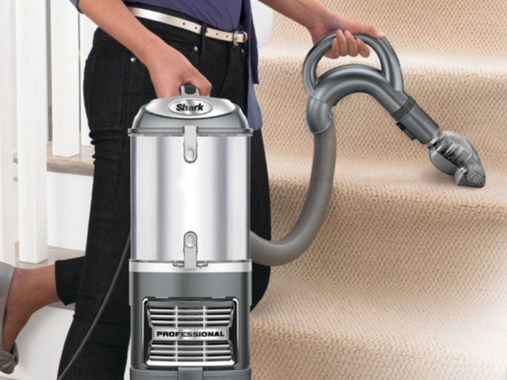 Woman cleaning stairs with Shark Refurbished UV540 Lift-Away Upright Vacuum