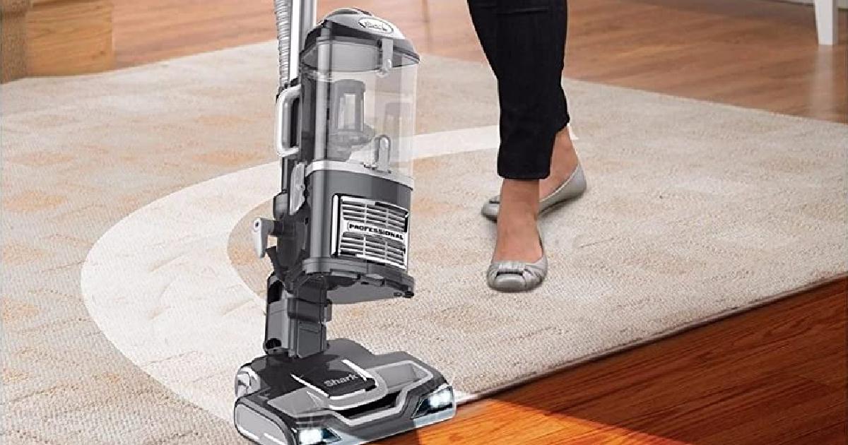 Woman vacuuming on an area rug
