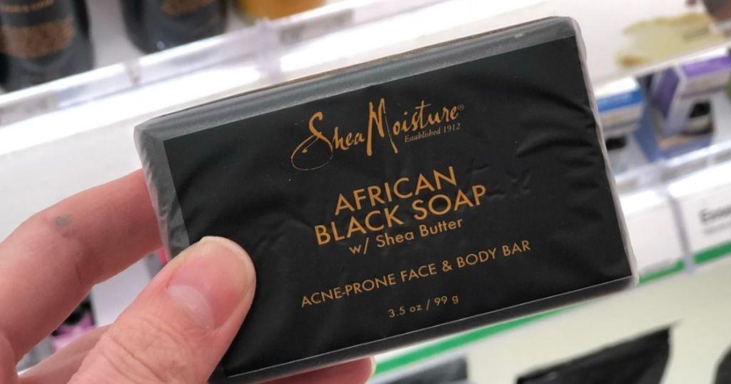hand holding a SheaMoisture Bar Soap