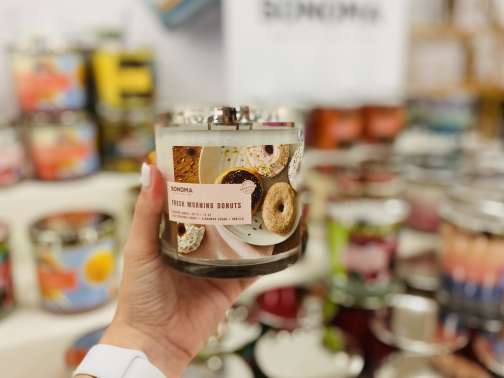 woman's hand holding a sonoma good 3-wick candle at kohl's