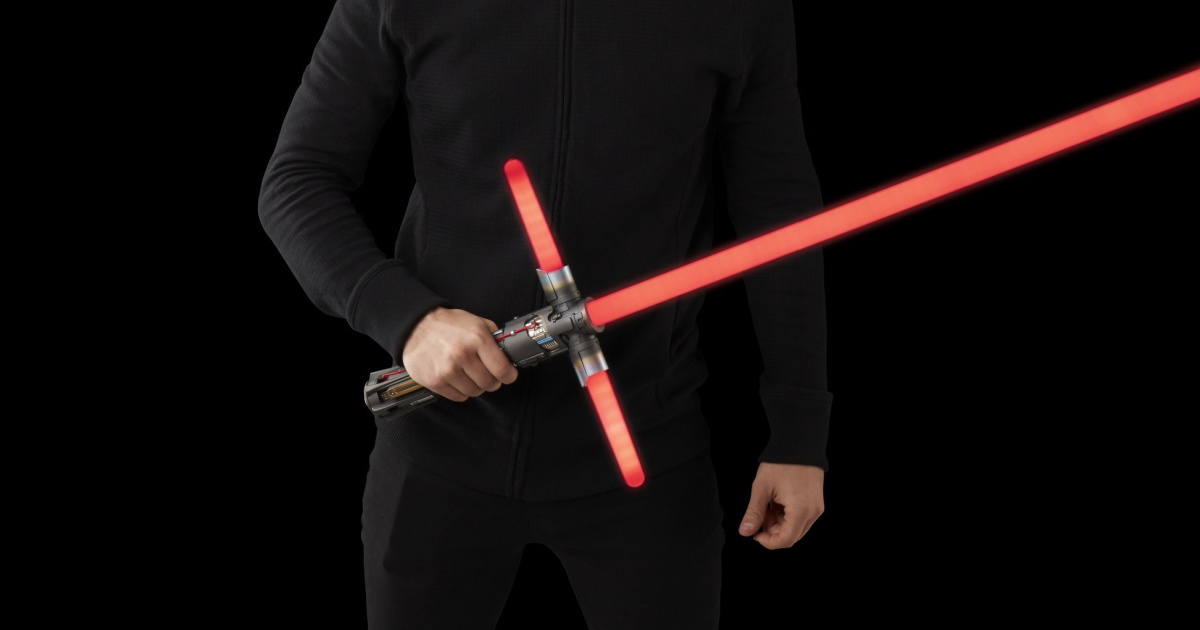 man dressed in black against a black background, holding a red lightsaber