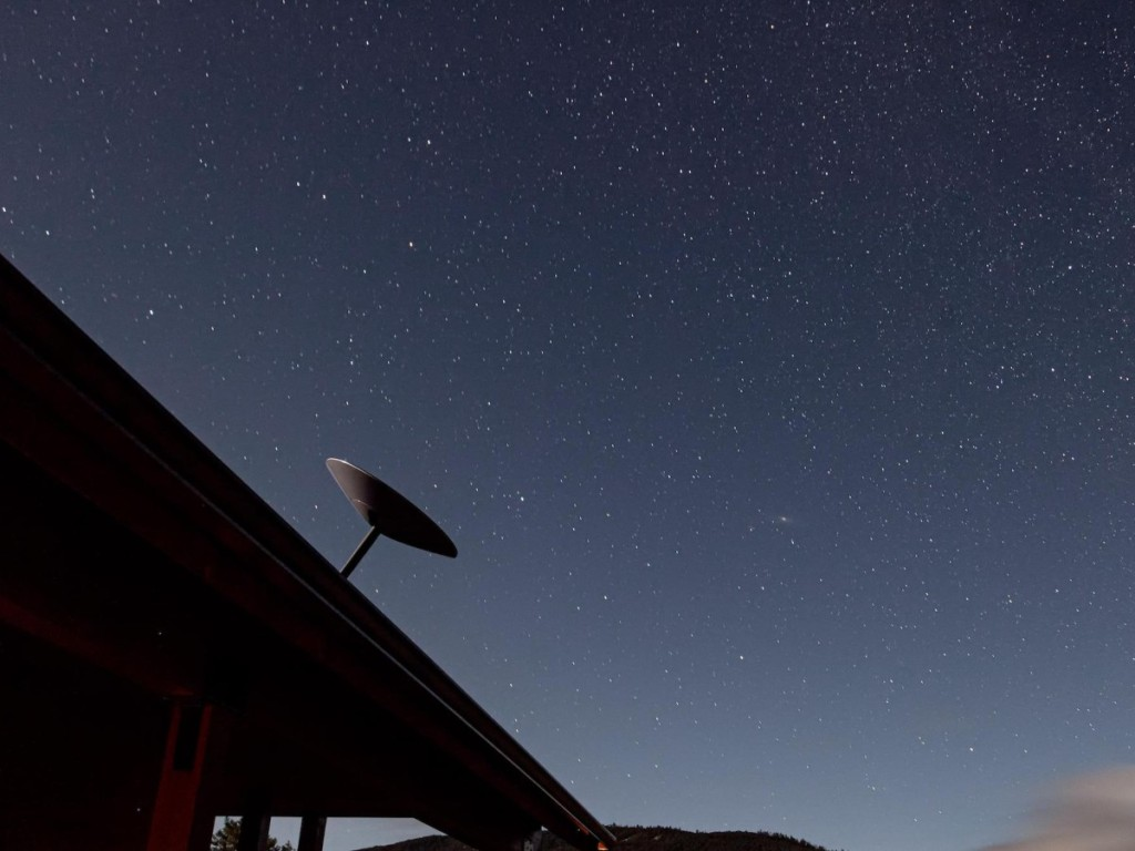 satellite dish against a starry sky