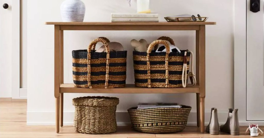 storage baskets on a console table
