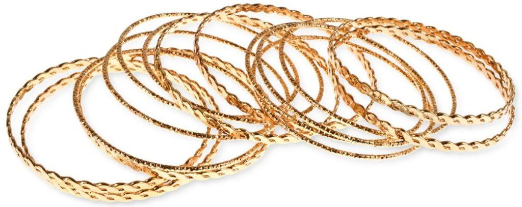 pile of gold bracelets