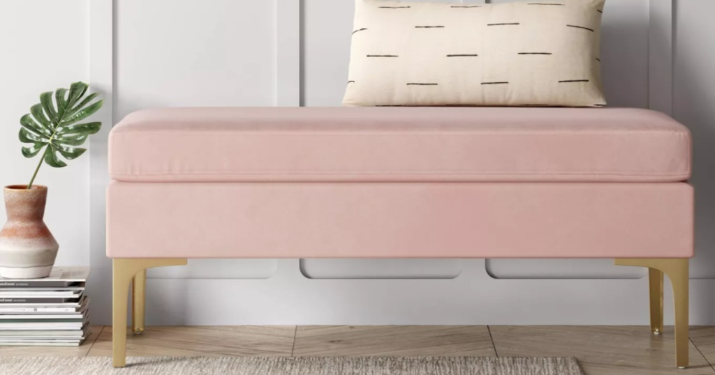 long light pink bench with a pillow on top
