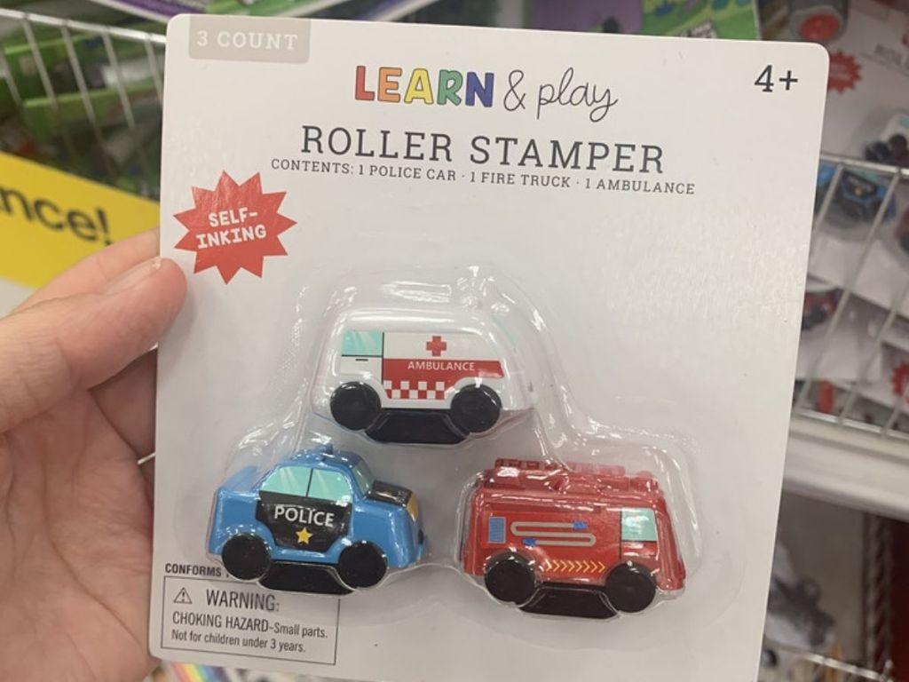 hand holding Target Learn & Play Roller Stamper Set