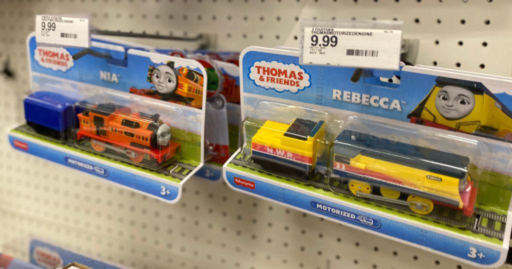 two toy trucks on shelf