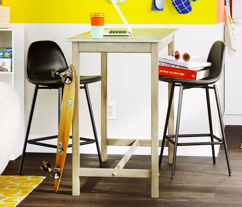 tall table with two barstools in an office space