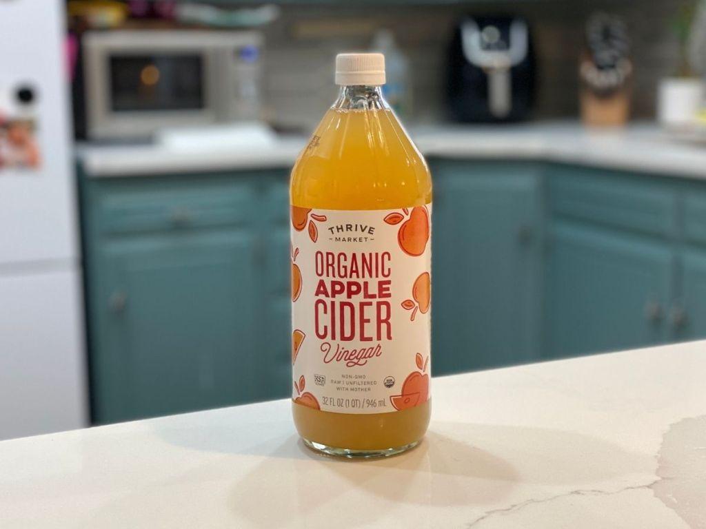 Thrive Organic Apple Cider Vinegar on kitchen counter