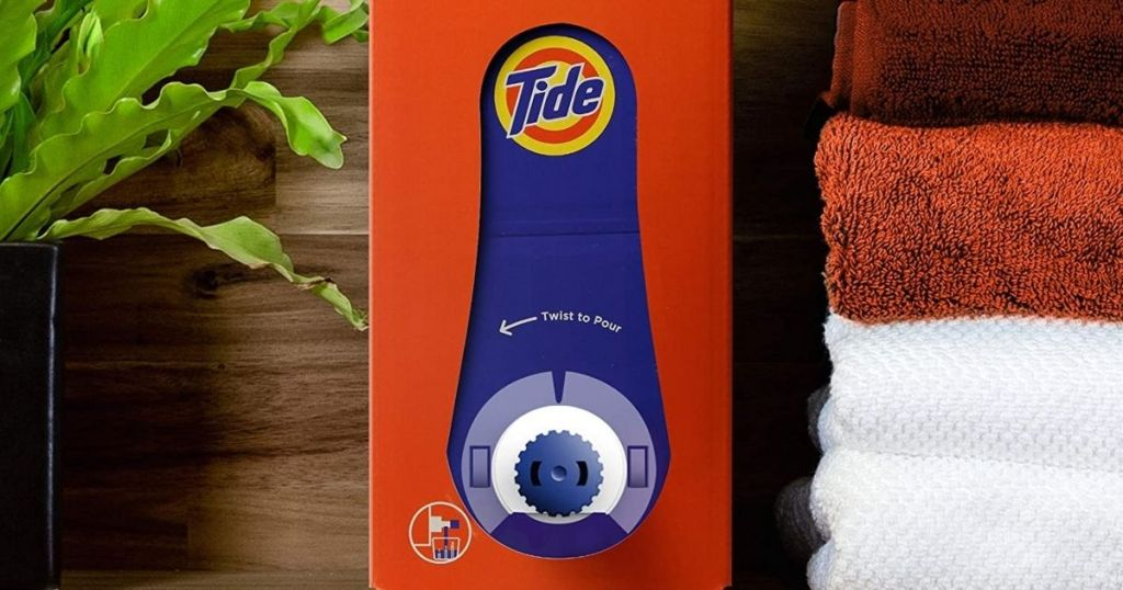 Tide Liquid Detergent Eco-Box with towels and plant