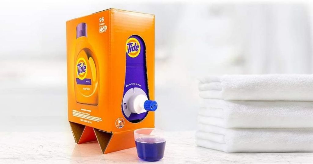 Tide Liquid Laundry Detergent Eco-Box with white towels