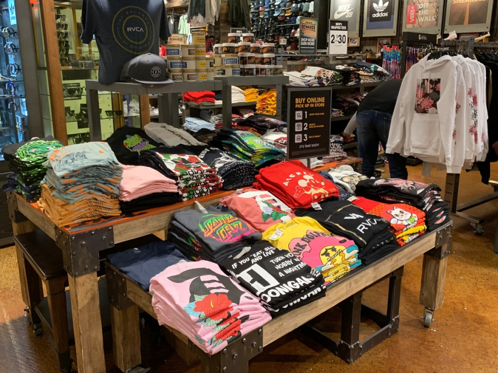 men's graphic tees display in store at tillys