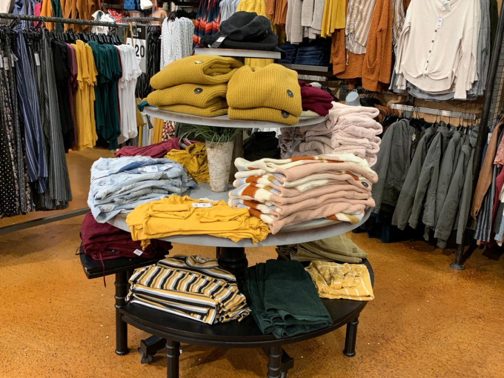 women's sweater display in store at tillys
