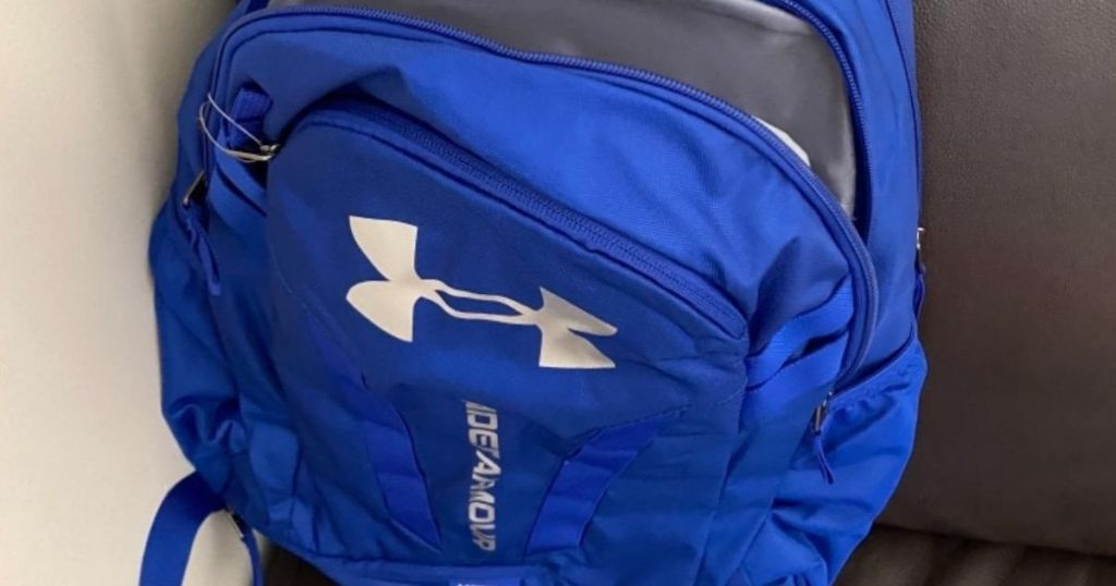 Under Armour Royal Blue Hustle Backpack slightly unzipped
