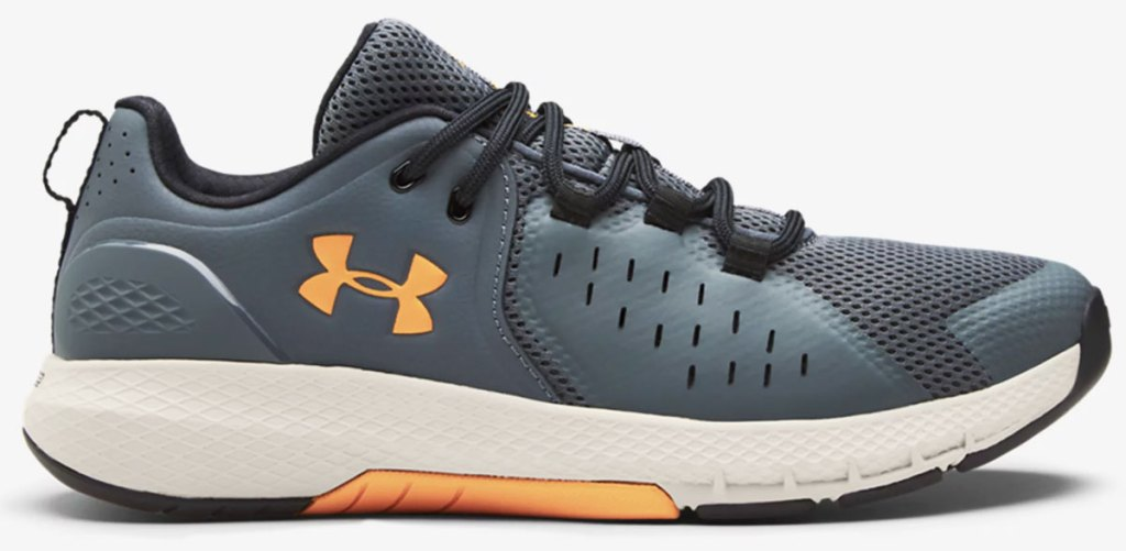 grey and orange men's under armour running shoe