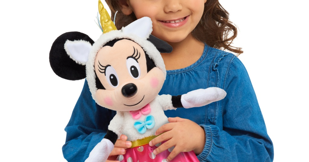 Young girl holding a Minnie Mouse plush