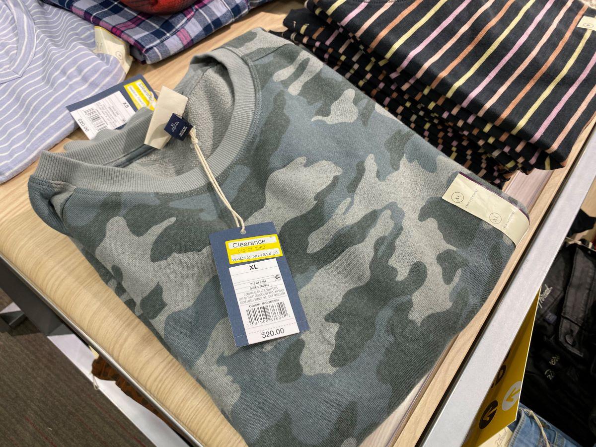 Universal Thread Camo Sweatshirt on a table