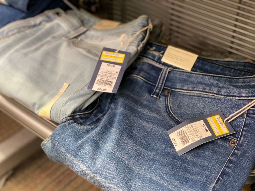 two pairs of jeans on a shelf
