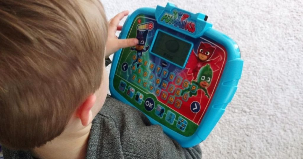 Little boy using a VTech PJ Masks Time to Be A Hero Learning Tablet