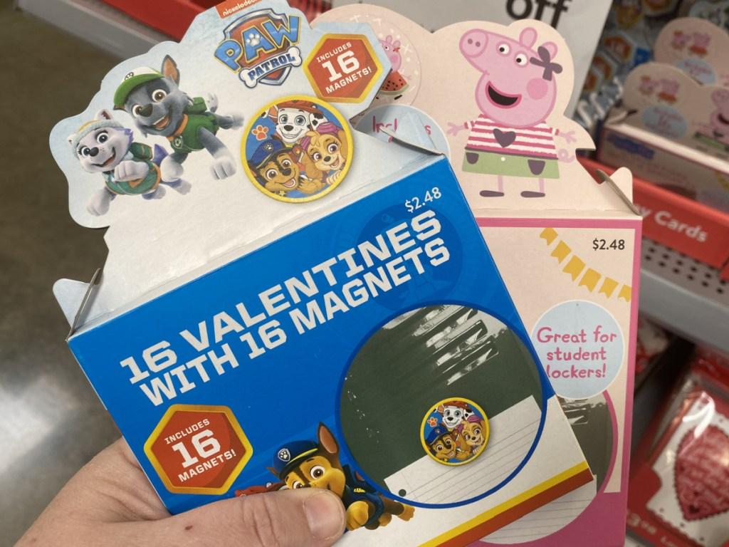 hand holding paw patrol valentine magnets
