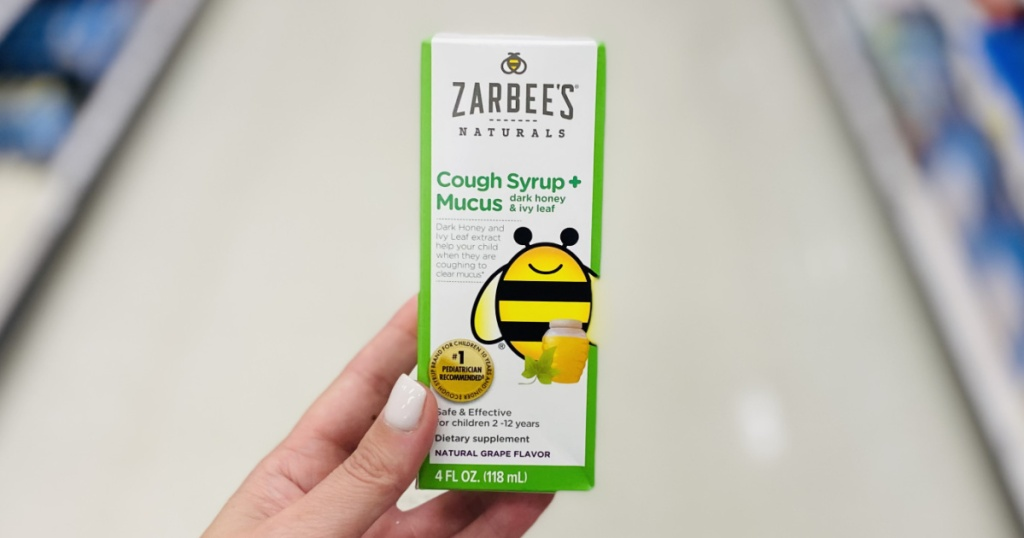 hand holding a box of zarbees cough syrup