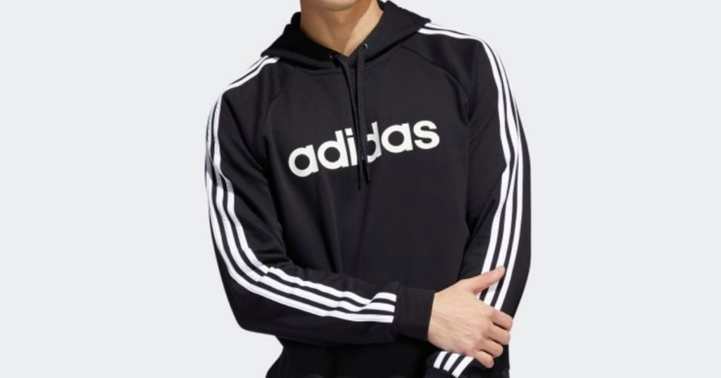 man wearing an adidas sweatshirt