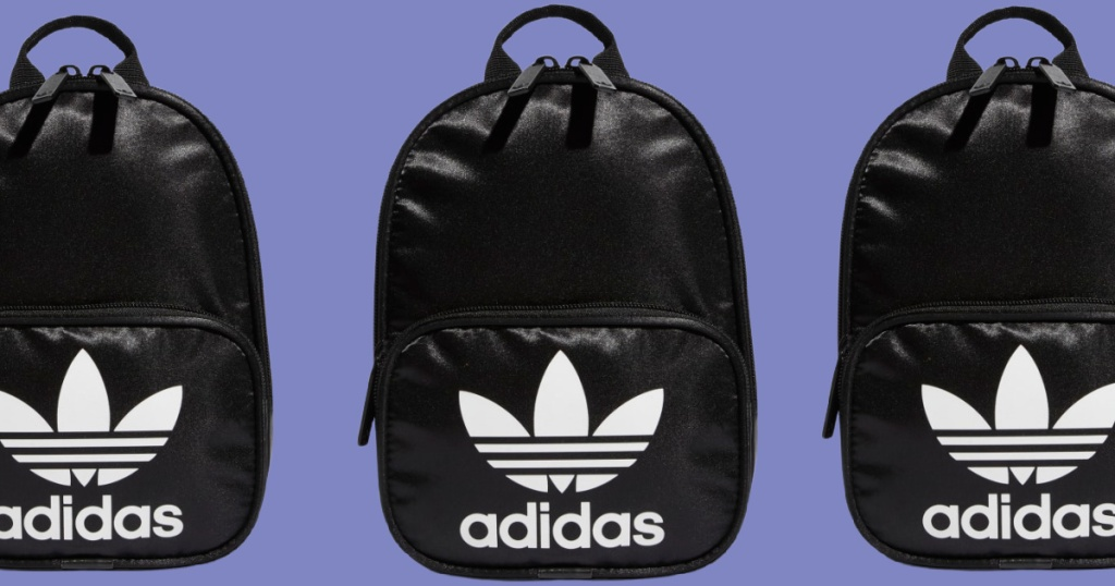 black and white adidas mini backpacks with purple background