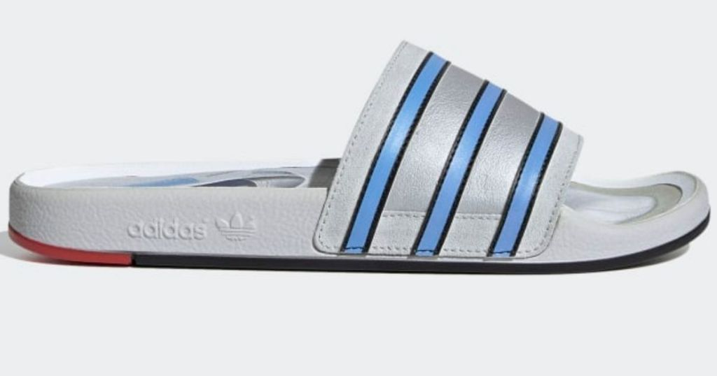 blue and silver adidas slides