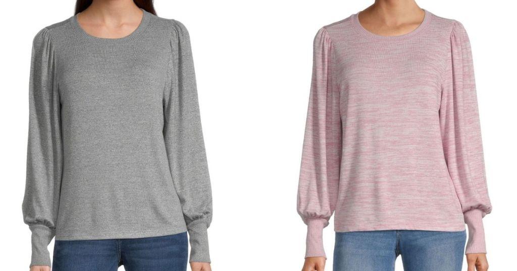 two women wearing long sleeve shirts