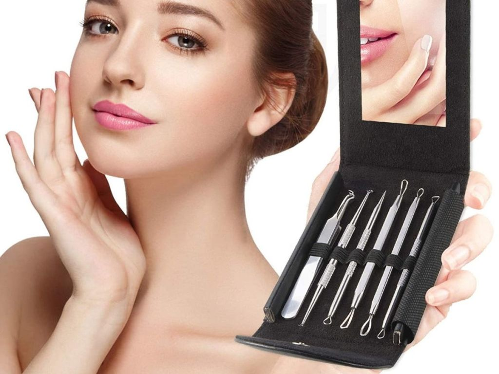 woman holding blackhead kit opened revealing tools and mirror